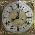 The dial of 'the Coy Man' clock which was made by clockmaker Thomas Hampson, in Chester around 1720.